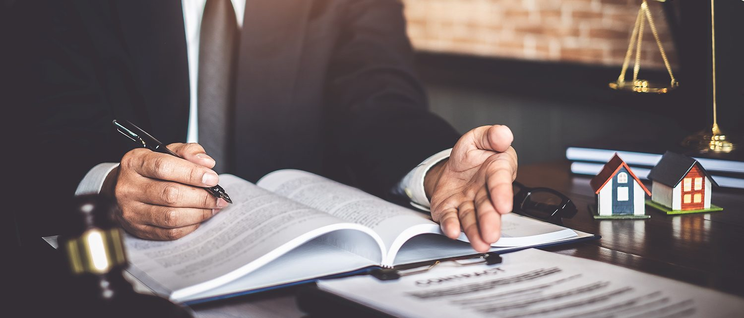 Close up of lawyer businessman working pointing at sign contract document in office workplace for consultant lawyer concept.